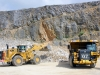 CAT large wheel loader and off-highway truck. Hillhead quarry face demo area