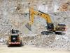 CAT large wheel loader and large excavator. Hillhead quarry face demo area