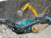 Powerscreen mobile screener. Rock processing demo area, Hillhead.