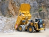 CAT off-highway truck. Hillhead quarry face demo area 1