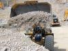 CAT large wheel loader. Hillhead quarry face demo area