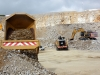 CAT articulated truck, large wheel loader and large excavator. Hillhead quarry face demo area