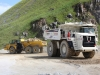 Komatsu articulated truck and Terex mining truck, rock processing demo area. Hillhead.