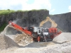 Sandvik crusher in the rock processing demo area at Hillhead Quarrying & Recycling Show