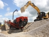 Sandvik crusher and CAT excavator working in the recycling demo area at Hillhead