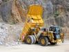 CAT off-highway truck. Hillhead quarry face demo area 1
