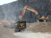 Tesab impact crusher and Case excavator in the rock processing demo area at Hillhead