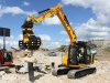 JCB excavator with selector grab attachment. Hillhead Quarrying & Recycling Show